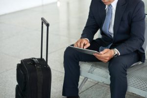 Airport Transportation Services - Man on tablet